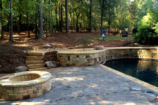 Hardscaping with pavers, firepit and salt water pool