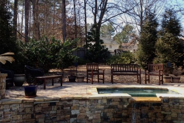 Backyard hardscape with hot tub and pool